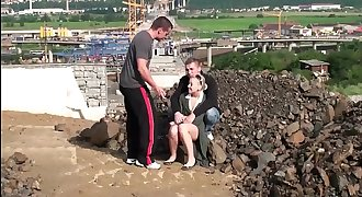 Very cute little teen lady PUBLIC gang bang threesom at a construction site